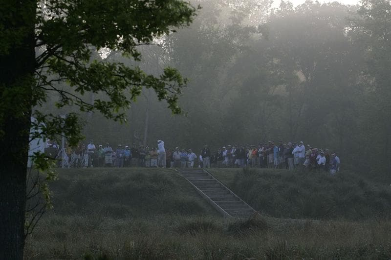 HUMBLE, TX - APRIL 01:  Players hit their drives on the 10th tee box after  fog delays the second round of the Shell Houston Open at Redstone Golf Club on April 1, 2011 in Humble, Texas.  (Photo by Michael Cohen/Getty Images)