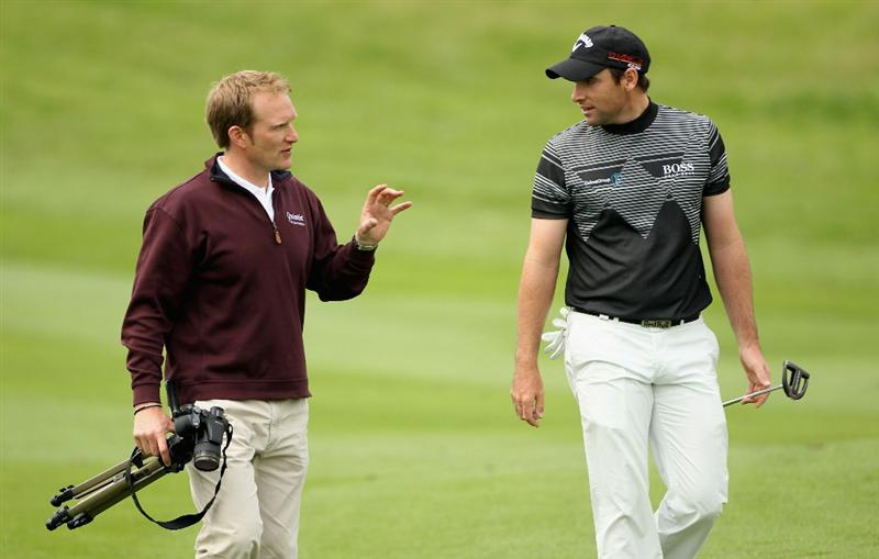 NEWPORT, WALES - JUNE 02:  Paul Hurrion, golf coach, walks with Oliver Wilson of England during the Pro Am prior to the start of the Celtic Manor Wales Open on The Twenty Ten Course at The Celtic Manor Resort on June 2 2010 in Newport, Wales.  (Photo by Andrew Redington/Getty Images)