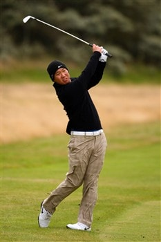 SOUTHPORT, UNITED KINGDOM - JULY 19:  Anthony Kim of the USA plays an approach to the 1st green during the third round of the 137th Open Championship on July 19, 2008 at Royal Birkdale Golf Club, Southport, England.  (Photo by Richard Heathcote/Getty Images)