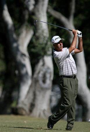 SAN ANTONIO - OCTOBER 25:  Mark James of England hits his approach shot  on the first hole  during the second round of  the AT&T Championship at Oak Hills Country Club on October 25, 2008 in San Antonio, Texas. (Photo by Thomas Shea/Getty Images)