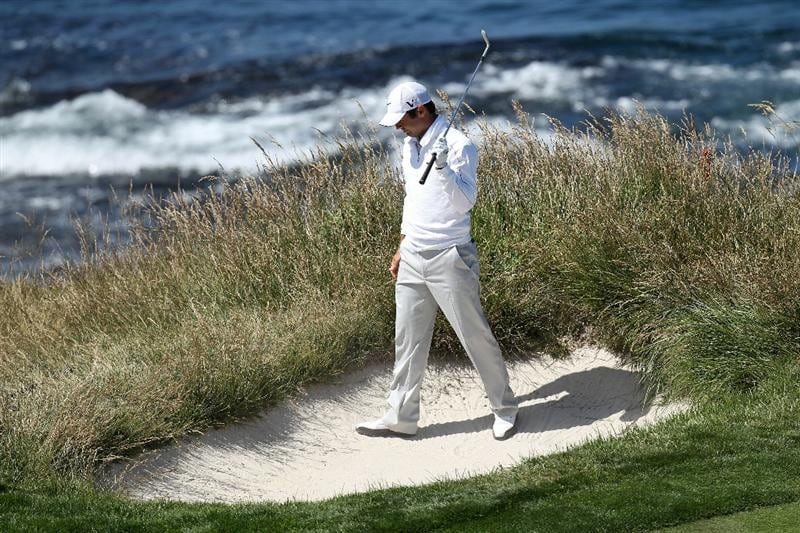 PEBBLE BEACH, CA - JUNE 17:  Trevor Immelman of South Africa plays left-handed from a bunker on the seventh hole green during the first round of the 110th U.S. Open at Pebble Beach Golf Links on June 17, 2010 in Pebble Beach, California.  (Photo by Ross Kinnaird/Getty Images)