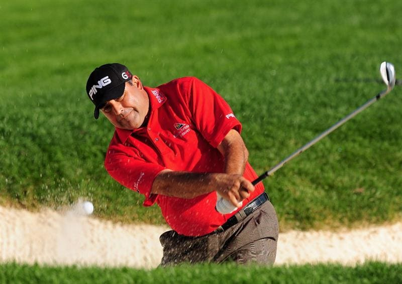AKRON, OH - AUGUST 06:  Angel Cabrera of Argentina plays his bunker shot on the 10th hole during the first round of the World Golf Championship Bridgestone Invitational on August 6, 2009 at Firestone Country Club in Akron, Ohio.  (Photo by Stuart Franklin/Getty Images)