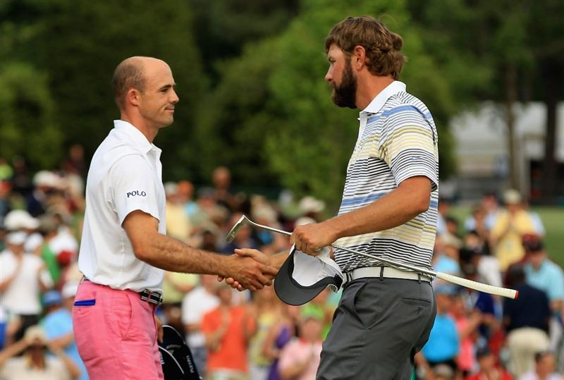 CHARLOTTE, NC - MAY 08:  Lucas Glover (R) shakes hands with Jonathan Byrd on the 18th green after defeating Byrd on the first playoff hole during the final round of the Wells Fargo Championship at the Quail Hollow Club on May 8, 2011 in Charlotte, North Carolina.  (Photo by Streeter Lecka/Getty Images)