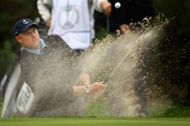DUMBARTON, SCOTLAND - SEPTEMBER 18: Eric Lippert of USA plays out the bunker on the 13th green in the afternoon four ball matches at The Carrick on Loch Lomond on September 18, 2009 in Dumbarton, Scotland.  (Photo by Jeff J Mitchell/Getty Images)