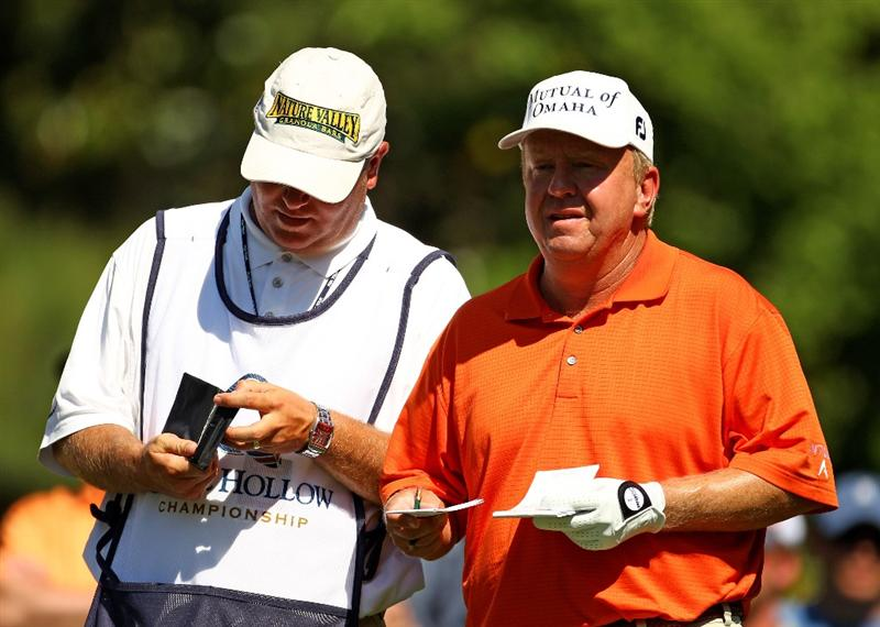 CHARLOTTE, NC - APRIL 30:  Billy Mayfair looks at his yardages with his caddy on the 6th tee during the second round of the Quail Hollow Championship at Quail Hollow Country Club on April 30, 2010 in Charlotte, North Carolina.  (Photo by Richard Heathcote/Getty Images)