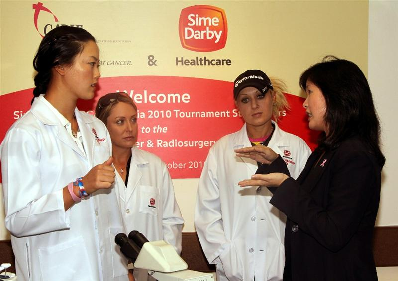 KUALA LUMPUR, MALAYSIA - OCTOBER 19 :  (L-R) Michelle Wie, Cristie Kerr and Natalie Gulbis of USA talk with Prof. Dr Teo Soo-Hwang of the Subang Medical Centre during the Sime Darby LPGA Charity visit to the Subang Medical Centre on October 19, 2010 in Kuala Lumpur, Malaysia (Photo by Stanley Chou/Getty Images)
