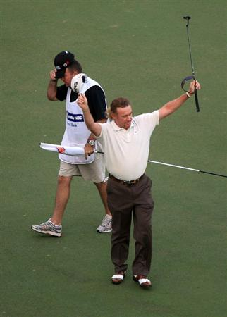 DUBAI, UNITED ARAB EMIRATES - FEBRUARY 07:  Miguel Angel Jimenez of Spain celebrates his victory over Lee Westwood of England at the 3rd play-off hole on the 9th green during the final round of the 2010 Omega Dubai Desert Classic on the Majilis Course at the Emirates Golf Club on February 7, 2010 in Dubai, United Arab Emirates.  (Photo by David Cannon/Getty Images)