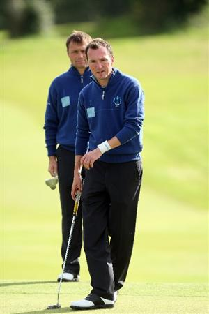 DUMBARTON, SCOTLAND - SEPTEMBER 18:  Jamie Harris of England (front) and Paul Simpson of England of the Great Britain and Ireland Team at the 9th hole during the afternoon fourball matches at The Carrick on Loch Lomond on September 19, 2009 in Dumbarton, Scotland.  (Photo by David Cannon/Getty Images)