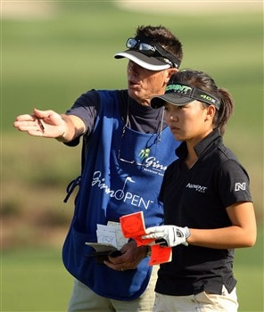 REUNION, FLORIDA - APRIL 18:  Teresa Lu of Taiwan chats with her caddie on the eighth hole during the second round of the Ginn Open at Reunion Resort on April 18, 2008 in Reunion, Florida.  (Photo by Scott Halleran/Getty Images)