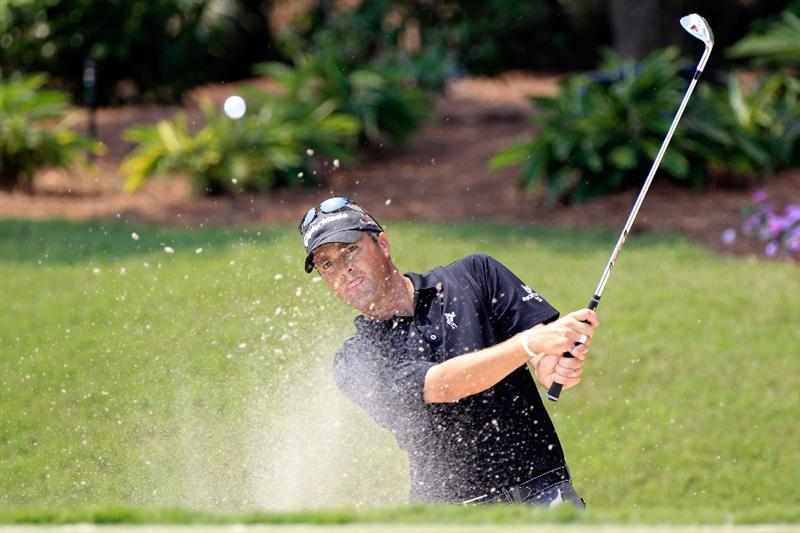PONTE VEDRA BEACH, FL - MAY 10:  Ryan Palmer hits from a bunker during a practice round prior to the start of THE PLAYERS Championship held at THE PLAYERS Stadium course at TPC Sawgrass on May 10, 2011 in Ponte Vedra Beach, Florida.  (Photo by Sam Greenwood/Getty Images)
