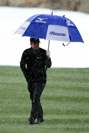 MARANA, AZ - FEBRUARY 27:  Luke Donald of England (R) holds an umbrella as he walks up the fourth fairway in poor weather during the final round of the Accenture Match Play Championship at the Ritz-Carlton Golf Club on February 27, 2011 in Marana, Arizona.  (Photo by Andy Lyons/Getty Images)