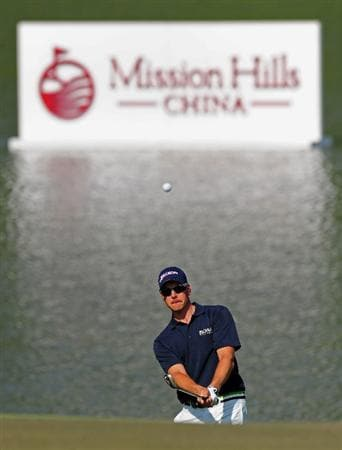 SHENZHEN, GUANGDONG - NOVEMBER 24:  Henrik Stenson of Sweden plays a shot during practice for the Omega Mission Hills World Cup on the Olazabal course on November 24, 2009 in Shenzhen, China.  (Photo by Stuart Franklin/Getty Images)