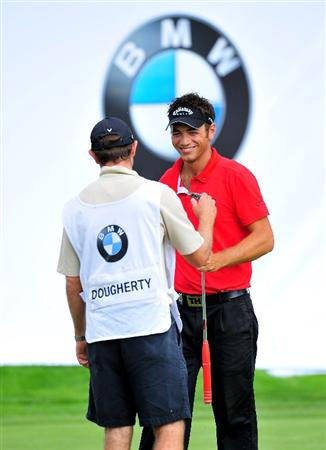 MUNICH, GERMANY - JUNE 26:  Nick Dougherty of England celebrates his putt with his caddie Mike Kerr on the 18th hole during the second round of The BMW International Open Golf at The Munich North Eichenried Golf Club on June 26, 2009, in Munich, Germany.  (Photo by Stuart Franklin/Getty Images)