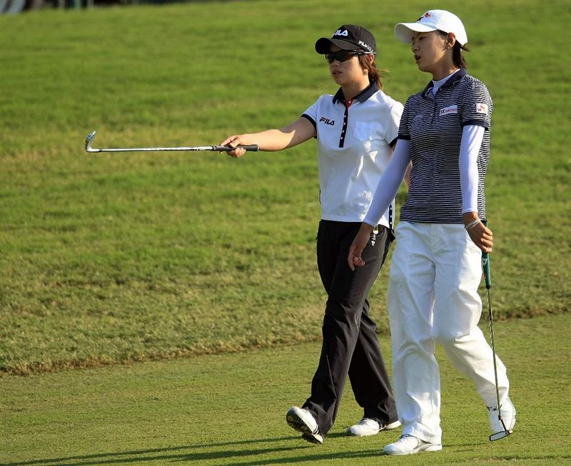 WEST PALM BEACH, FL - NOVEMBER 21:  Eun-Hee Ji and Na Yeon Choi of South Korea walk on the 16th hole during the second round of the ADT Championship at the Trump International Golf Club on November 21, 2008 in West Palm Beach, Florida.  (Photo by Scott Halleran/Getty Images)