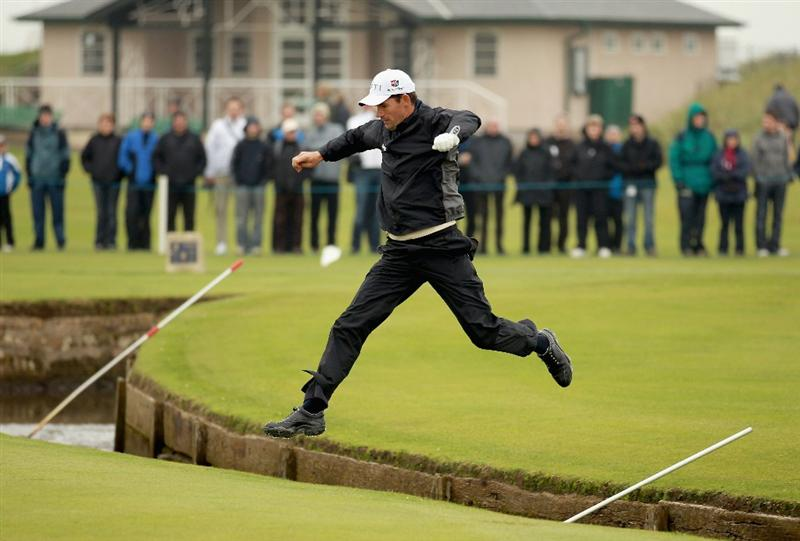 ST ANDREWS, SCOTLAND - OCTOBER 10:  Padraig Harrington of Ireland jumps ove the burn on the first hole during the final round of The Alfred Dunhill Links Championship at The Old Course on October 10, 2010 in St Andrews, Scotland.  (Photo by Warren Little/Getty Images).