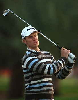 ABU DHABI, UNITED ARAB EMIRATES - JANUARY 17:  Magnus A Carlsson of Sweden hits his second shot on the tenth hole during the first round of The Abu Dhabi Golf Championship at Abu Dhabi Golf Club on January 17, 2008 in Abu Dhabi.  (Photo by Andrew Redington/Getty Images)