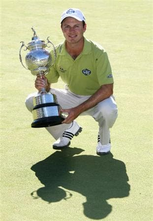 PAARL, SOUTH AFRICA - DECEMBER 21:  Richard Sterne of South Africa poses with the trophy after winning the South African Open Championship on the first play-off hole against Gareth Maybin of Northern Ireland at Pearl Valley Golf & Country Club on December 21, 2008 in Paarl, South Africa.  (Photo by Warren Little/Getty Images)