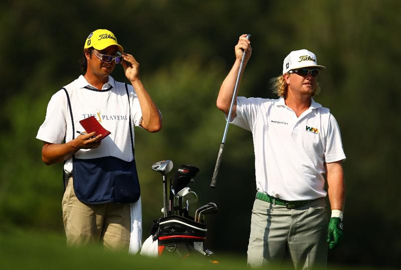 PONTE VEDRA BEACH, FL - MAY 08:  Charley Hoffman (R) pulls a club from his bag alongside his caddie Miguel Rivera on the 14th hole during the third round of THE PLAYERS Championship held at THE PLAYERS Stadium course at TPC Sawgrass on May 8, 2010 in Ponte Vedra Beach, Florida.  (Photo by Richard Heathcote/Getty Images)