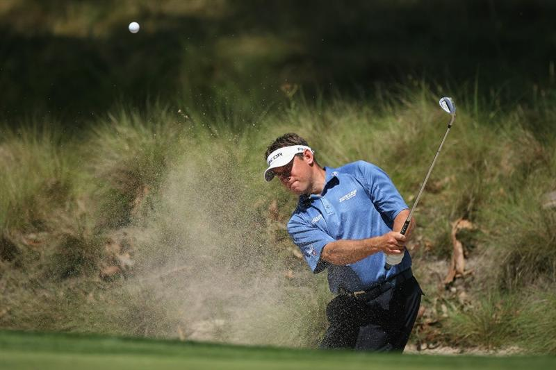 PAARL, SOUTH AFRICA - DECEMBER 16:  Lee Westwood of England plays out of the third greenside bunker during practice before the South African Open Championship at Pearl Valley Golf Club on December 16, 2008 in Paarl, South Africa.  (Photo by Warren Little/Getty Images)