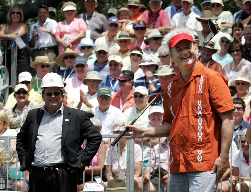 LUTZ, FL - APRIL 18:  Actor Bill Murray (R)  prepares to tee off, as the starter wears a hard hat, on the first during the second round of the Outback Steakhouse Pro-Am at TPC Tampa Bay on April 18, 2009  in Lutz, Florida.  (Photo by Marc Serota/Getty Images)