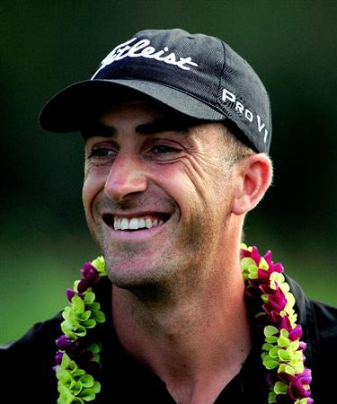 KAPALUA, HI - JANUARY 10:  Geoff Ogilvy of Australia smiles after winning the SBS Championship at the Plantation course on January 10, 2010 in Kapalua, Maui, Hawaii.  (Photo by Sam Greenwood/Getty Images)