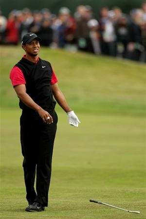 PEBBLE BEACH, CA - JUNE 20:  Tiger Woods reacts to a poor shot on the 14th hole during the final round of the 110th U.S. Open at Pebble Beach Golf Links on June 20, 2010 in Pebble Beach, California.  (Photo by Andrew Redington/Getty Images)