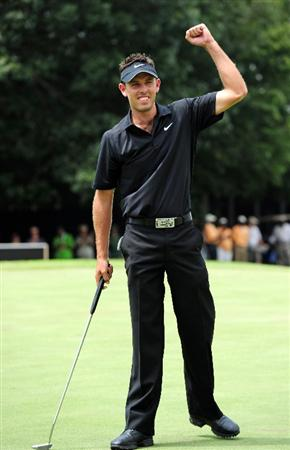 JOHANNESBURG, SOUTH AFRICA - JANUARY 17:  Charl Schwartzel of South Africa celebrates winning on the 18th  hole during the final round of the Joburg Open at Royal Johannesburg and Kensington Golf Club on January 17, 2010 in Johannesburg, South Africa.  (Photo by Stuart Franklin/Getty Images)