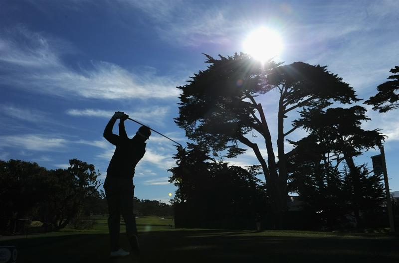 PEBBLE BEACH, CA - FEBRUARY 13:  Stuart Appleby of Australia plays his tee shot on the fourth hole during the final round of the AT&T Pebble Beach National Pro-Am at Pebble Beach Golf Links on February 13, 2011  in Pebble Beach, California.  (Photo by Stuart Franklin/Getty Images)
