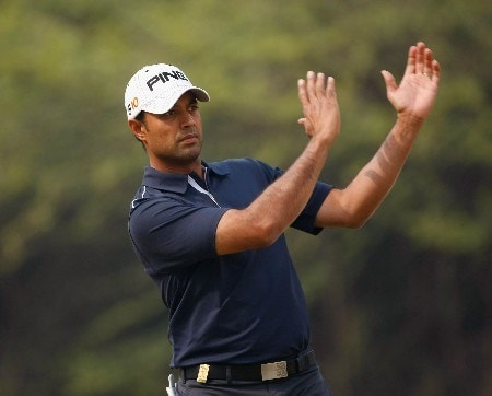 NEW DELHI, INDIA - FEBRUARY 07:  Arjun Atwal of India practices his approach shot on the fourth hole during the first round of the Emaar-MGF Indian Masters at the Delhi Golf Club on February 7, 2008 in Delhi, India.  (Photo by Stuart Franklin/Getty Images)