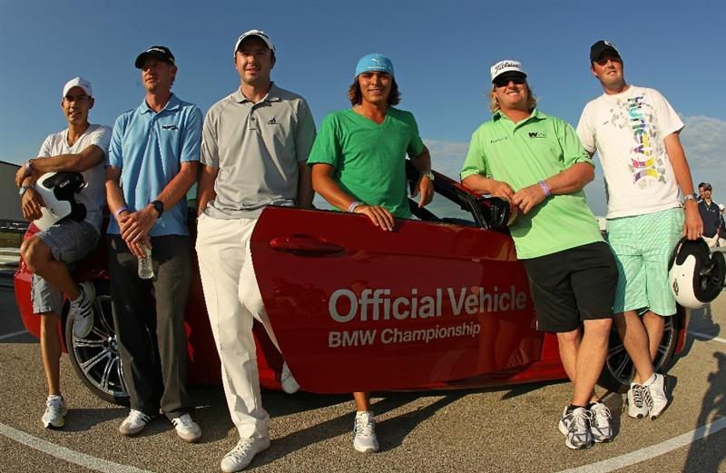 JOLIET, IL - SEPTEMBER 09:  PGA Tour players (L-R) Camilo Villegas, Vaughn Taylor, Martin Laird, Rickie Fowler, Charley Hoffman and Marc Leishman pose for a photo after test driving BMW cars at the Autobahn Country Club Racetrack on September 9, 2010 in Joliet, Illinois.  (Photo by Scott Halleran/Getty Images)