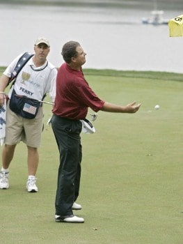 Kenny Perry of the U.S. team tosses his ball to the crowd after beating Mark Hensby of the International team during the singles matches in the final round of The Presidents Cup at Robert Trent Jones Golf Club in Prince William County, Virginia on September 25, 2005.Photo by Stan Badz/PGA TOUR/WireImage.com