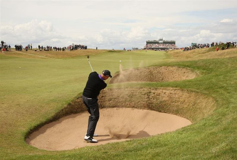 TURNBERRY, SCOTLAND - JULY 18:  Stewart Cink of USA hits out of a bunker during round three of the 138th Open Championship on the Ailsa Course, Turnberry Golf Club on July 18, 2009 in Turnberry, Scotland.  (Photo by Ross Kinnaird/Getty Images)