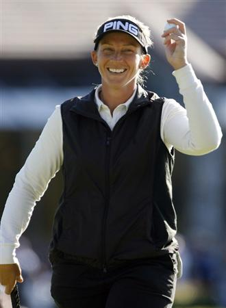DANVILLE, CA - OCTOBER 11: Angela Stanford waves her ball to the crowd after completing the third round of the LPGA Longs Drugs Challenge at the Blackhawk Country Club October 11, 2008 in Danville, California. (Photo by Max Morse/Getty Images)