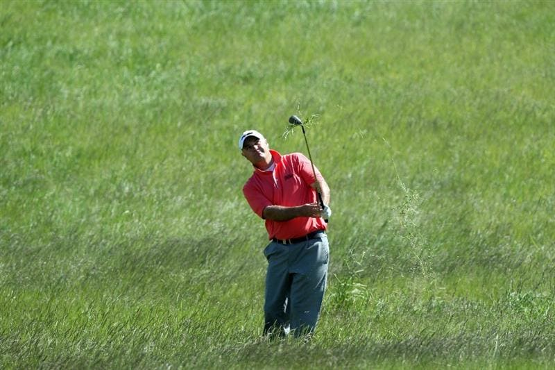 ASH, UNITED KINGDOM - MAY 31:  Stephen Dodd of Wales hits his second shot at the 17th hole during the final round of the 2009 European Open at the London Golf Club on May 31, 2009 in Ash, England.  (Photo by David Cannon/Getty Images)