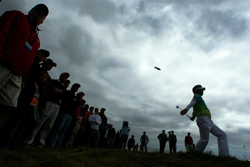 PEBBLE BEACH, CA - JUNE 18:  Y.E. Yang of South Korea hits from the rough on the 11th hole in front of a gallery of fans during the second round of the 110th U.S. Open at Pebble Beach Golf Links on June 18, 2010 in Pebble Beach, California.  (Photo by Donald Miralle/Getty Images)