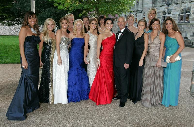 CARDIFF, WALES - SEPTEMBER 29:  USA Team captain Corey Pavin and the wives and partners of the United States Ryder Cup team pose for a photograph during the 2010 Ryder Cup Dinner at Cardiff Castle on September 29, 2010 in Cardiff, Wales.  (Photo by Andrew Redington/Getty Images)