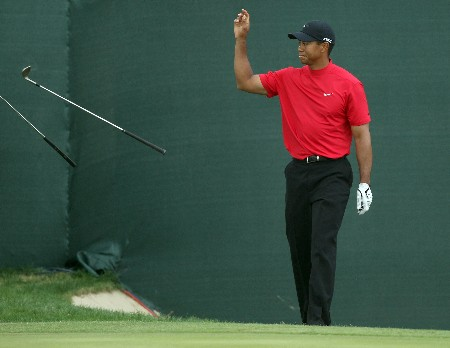 DUBAI, UNITED ARAB EMIRATES - FEBRUARY 03:  Tiger Woods of the USA is unhappy with his third shot at the 18th hole during the final round of the Dubai Desert Classic, on the Majilis Course at the Emirates Golf Club, on February 3, 2008 in Dubai, United Arab Emirates.  (Photo by David Cannon/Getty Images)