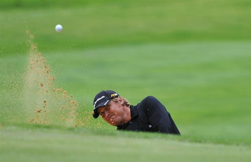 PARIS - SEPTEMBER 23:  Jarmo Sandelin of Sweden plays a bunker shot on  the 3rd hole during day one of the Vivendi Cup at Joyenval golf course on September 23, 2010 in Paris, France.  (Photo by Pascal Le Segretain/Getty Images)