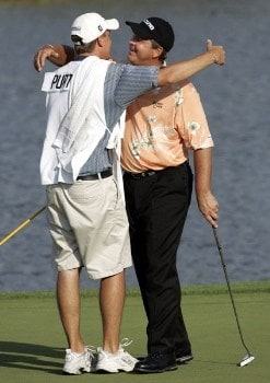 Tom Purtzer hugs his caddie on the 18th green after winning the 3M Championship, August 7, 2005, held at the TPC of the Twin Cities, Blaine, Minnesota. Purtzer finished -15 holding off Craig Stadler and Lonnie Nielsen for a one shot victory.Photo by Gregory Shamus/WireImage.com