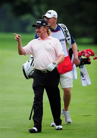 AKRON, OH - AUGUST 08: Miguel Angel Jimenez of Spain looks happy during the third round of the World Golf Championship Bridgestone Invitational on August 8, 2009 at Firestone Country Club in Akron, Ohio. (Photo by Stuart Franklin/Getty Images)