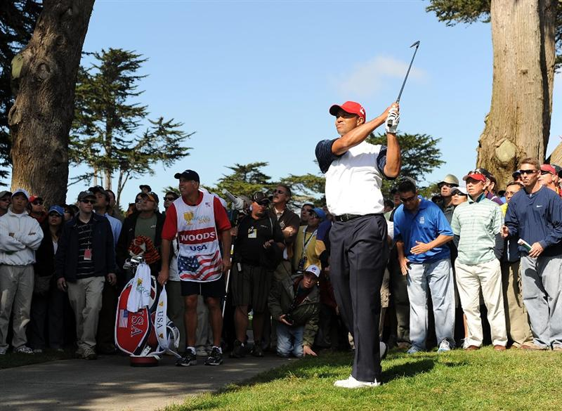 SAN FRANCISCO - OCTOBER 09:  Tiger Woods of the USA Team hits from the rough on the fourth hole  during the Day Two Fourball Matches of The Presidents Cup at Harding Park Golf Course on October 9, 2009 in San Francisco, California.  (Photo by Harry How/Getty Images)