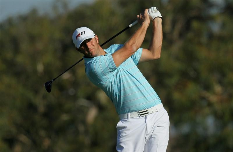 LA JOLLA, CA - JANUARY 29:  Dustin Johnson hits his tee shot on the second hole during round three of the Farmers Insurance Open at Torrey Pines South Course on January 29, 2011 in La Jolla, California.  (Photo by Stephen Dunn/Getty Images)