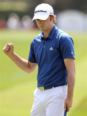 ORLANDO, FL - MARCH 27:  Martin Laird of Scotland reacts to a par putt on the 2nd hole during the Arnold Palmer Invitational presented by MasterCard at the Bay Hill Club and Lodge on March 27, 2011 in Orlando, Florida.  (Photo by Sam Greenwood/Getty Images)