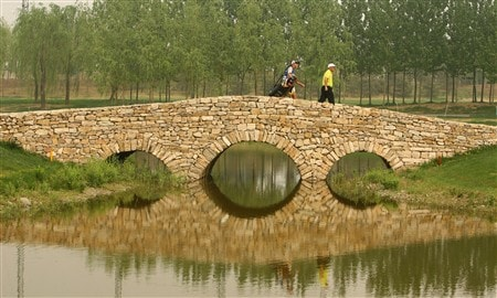 BEIJING - APRIL 19:  Damien McGrane of Ireland walks to the 9th green during the 3rd round of the Volvo China Open at the Beijing CBD International Golf Club on April 19, 2008 in Beijing, China.  (Photo by Ian Walton/Getty Images)