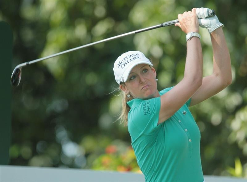 SINGAPORE - FEBRUARY 25:  Cristie Kerr of the USA watches a shot on the 14th hole during the second round of the HSBC Women's Champions 2011 at the Tanah Merah Country Club on February 25, 2011 in Singapore, Singapore.  (Photo by Scott Halleran/Getty Images)