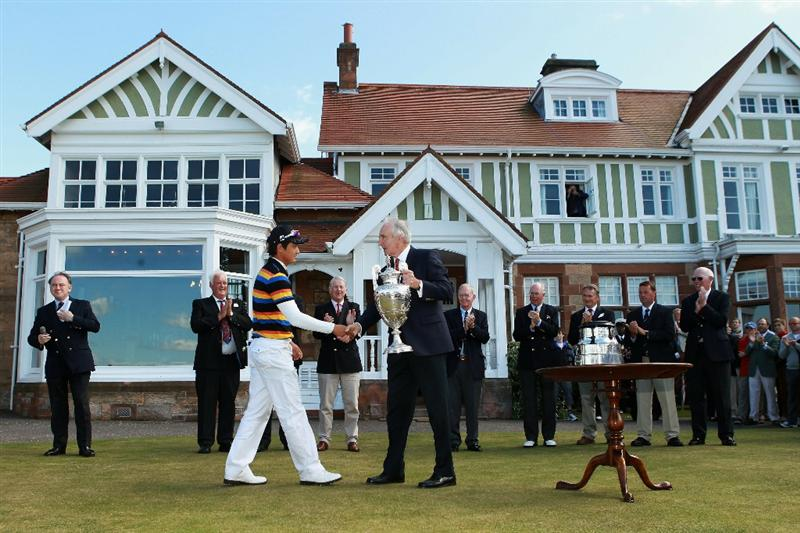 GULLANE, SCOTLAND - JUNE 19:  Jin Jeong of South Korea is awarded the trophy by Alistair Low, the Muirfield captain after beating James Byrne of Scotland 5&4 to win The Amateur Championship at Muirfield Golf Club on June 19, 2010 in Gullane, Scotland.  (Photo by Warren Little/Getty Images)