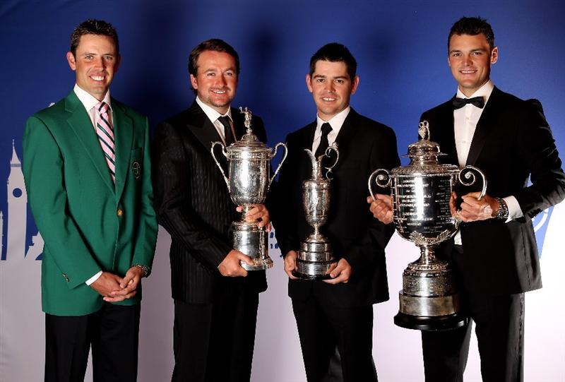 VIRGINIA WATER, ENGLAND - MAY 24:  Major Winners (L-R)  Charl Schwartzel, Graeme McDowell, Louis Oosthuizen and Martin Kaymer pose during the European Tour Dinner at The Wentworth Club on May 24, 2011 in Virginia Water, England.  (Photo by Andrew Redington/Getty Images)