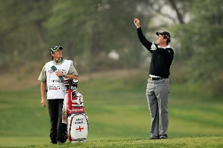 DOHA, QATAR - JANUARY 25:  David Howell of England checks the direction of the wind, watched by his caddie Nick Mimford during the second round of the Commercial Bank Qatar Masters held at the Doha Golf Club on January 25, 2008 in Doha,Qatar.  (Photo by Ross Kinnaird/Getty Images)