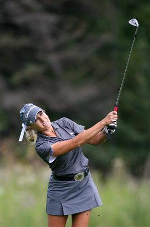 CALGARY, AB - SEPTEMBER 03: Natalie Gulbis of the United States hits her third shot on the ninth hole during the first round of the Canadian Women's Open at Priddis Greens Golf & Country Club on September 3, 2009 in Calgary, Alberta, Canada. (Photo by Hunter Martin/Getty Images)
