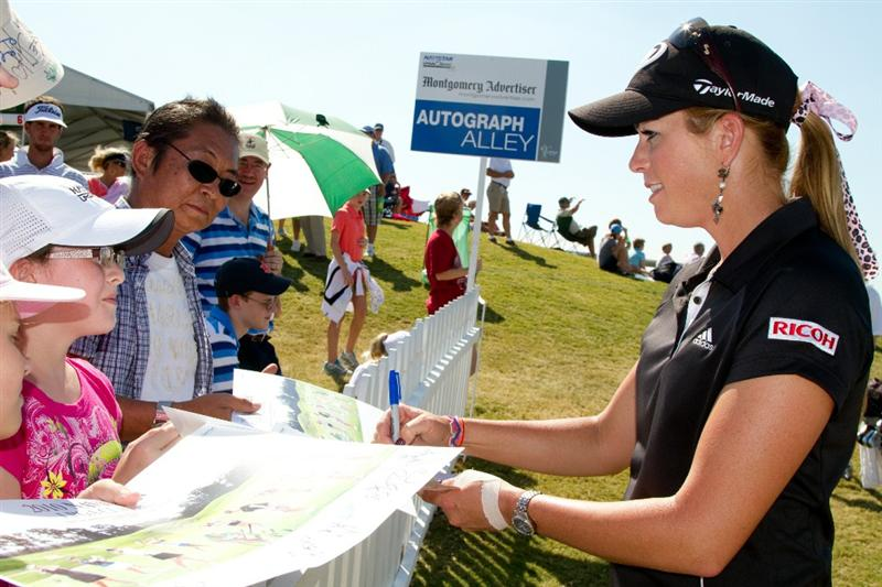 PRATTVILLE, AL - OCTOBER 9: Paula Creamer signs autographs following the third round of the Navistar LPGA Classic at the Senator Course at the Robert Trent Jones Golf Trail on October 9, 2010 in Prattville, Alabama. (Photo by Darren Carroll/Getty Images)